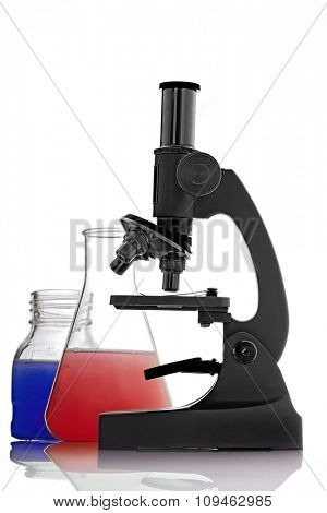 laboratory microscope and beakers