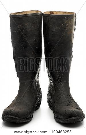 black rubber boots on white