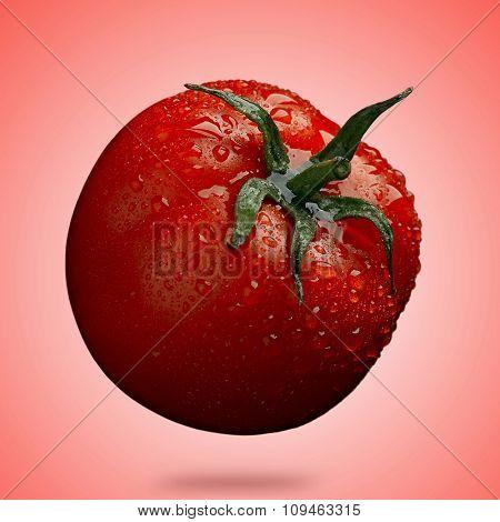ripe tomato on red