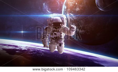 Beautiful giant planets in front of glowing star. Elements of this image furnished by NASA