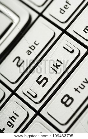 closeup of numbers on a cell phone dial