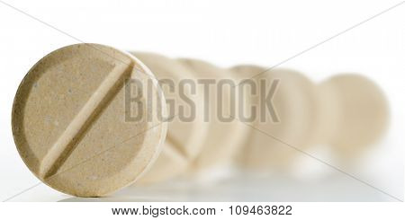 row of pills - focus on a closest one