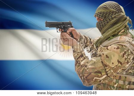 Male In Muslim Keffiyeh With Gun In Hand And National Flag On Background - Argentina