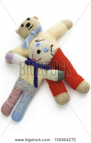 two handmade knitted toys on white