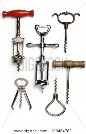 collection of vintage corkscrews on white