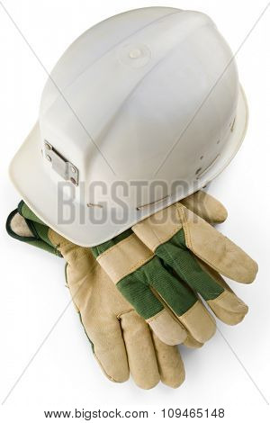 a white helmet and protective gloves on white