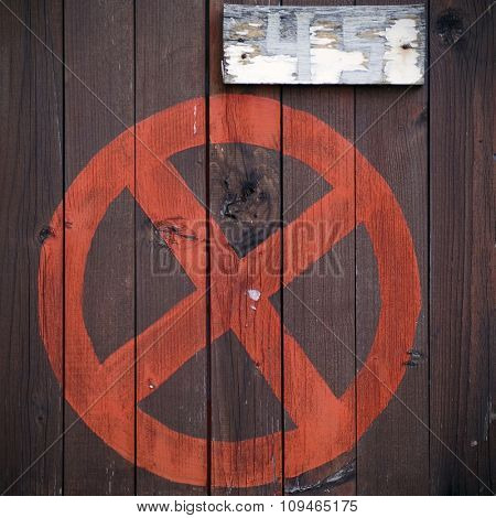 no parking sign painted on board fence