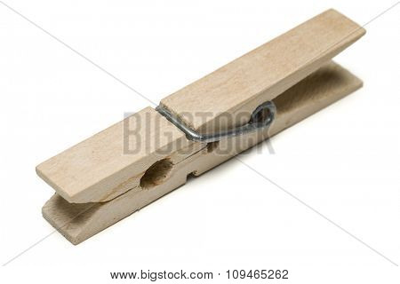 a wooden clothes clip on white