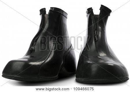 black rubber galoshes on white