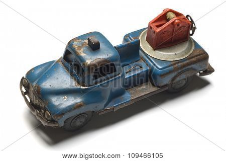 an old rusty toy tow truck on white