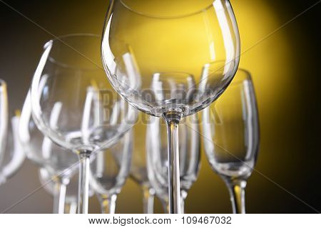 Empty wine glasses on yellow background