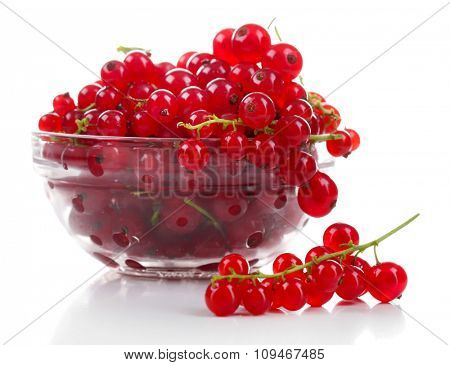Fresh red currants in glass bowl isolated on white