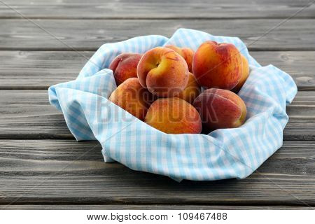 Sweet ripe peaches on table close up