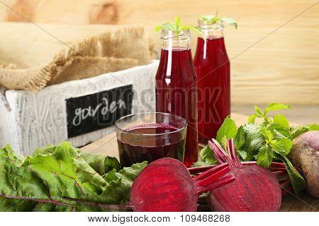 Fresh beet juice on wooden table, closeup