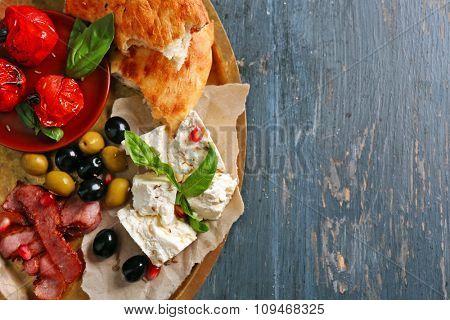 Ingredients of Mediterranean cuisine, on wooden tray, on wooden background