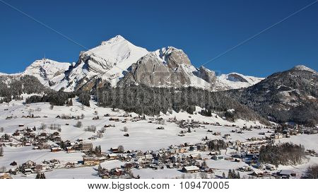 Snow Covered Mt Säntis And Village Wildhaus