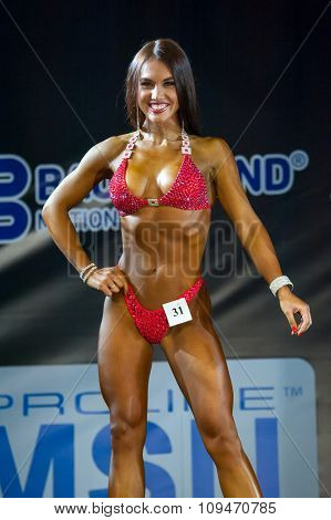 MOSCOW, RUSSIA - NOVEMBER 21, 2015: Evgenia Krasnova participates in Bodybuilding Champions Cup during SN Pro Expo Forum 2015 on November 21, 2015 in Moscow, Russia