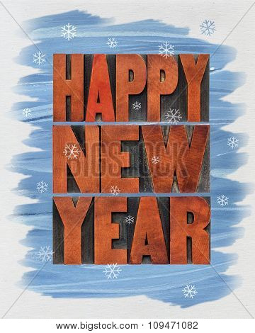 Happy New Year greeting card  - a collage of  text in vintage letterpress wood type blocks and watercolor painting on canvas
