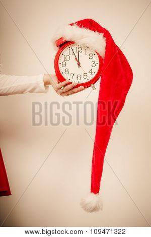 Closeup Of Woman With Alarm Clock. Christmas Time.