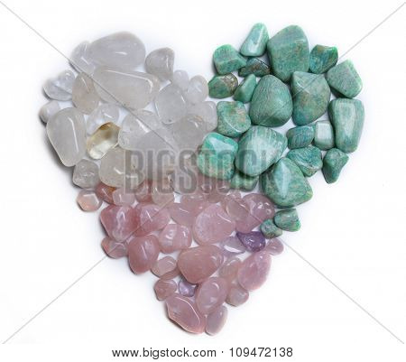 Heart shape of mineral stones: azonite, pink quartz, rock crystal isolated on white background