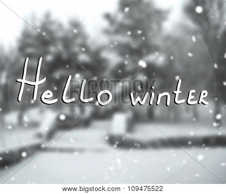 Blured forest and inscription: hello winter