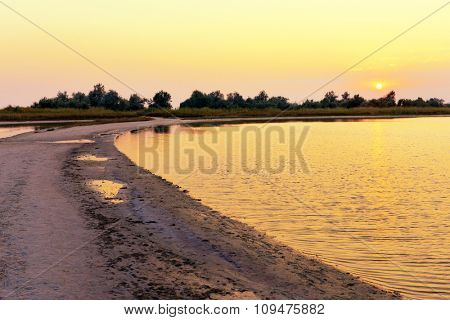 Beautiful evening summer shore in the country