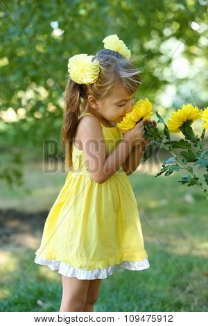 Little girl with flowers outside