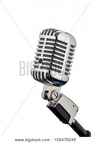 an old retro microphone in front of a white background.