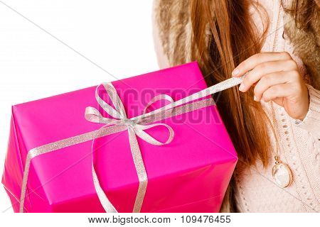 Girl Unpaking Gift Box.
