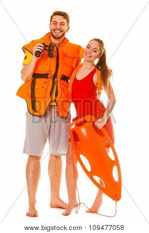 Lifeguards In Life Vest With Rescue Buoy.