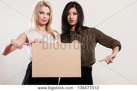 Two Women With Blank Board