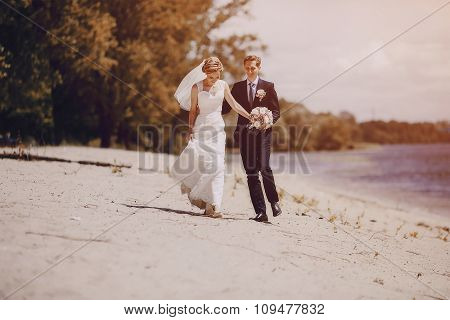 couple on the lake beach