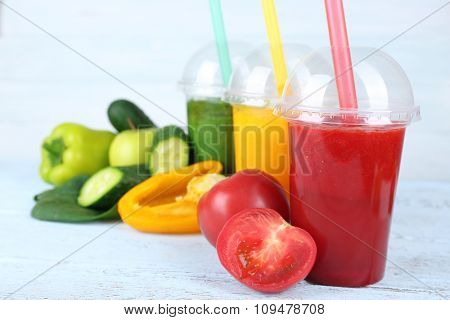 Fresh juice mix fruit, healthy drinks on color wooden background