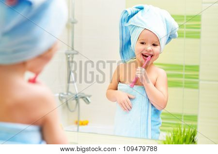 Funny Little Girl Cleans Teeth With Toothbrush In Bathroom