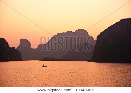 Sunset In Halong Bay, Vietnam. Unesco World Heritage Site.