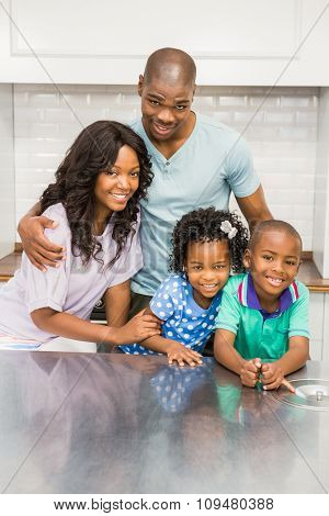 Happy family in the kitchen at home