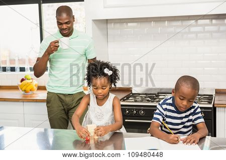 Father and children in the kitchen at home