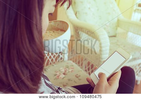 Woman Drinking Hot Coffee In Cafe And Use A Mobile Phone With Blank Touch Screen, Playing Social Net
