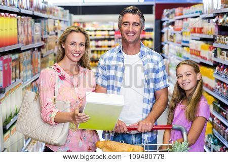 Portrait of happy family in the supermarket