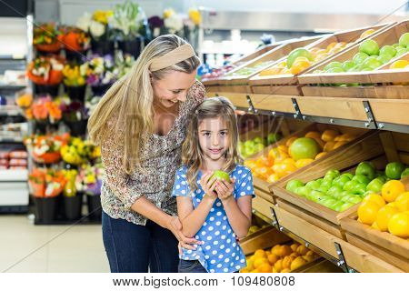 Mother and daughter at grocery shop