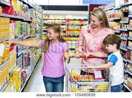 Mother and kids at the supermarket together