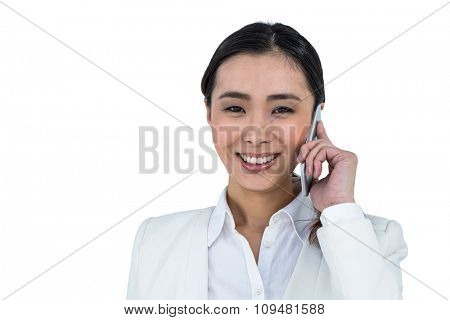 Smiling businesswoman using her phone against white background