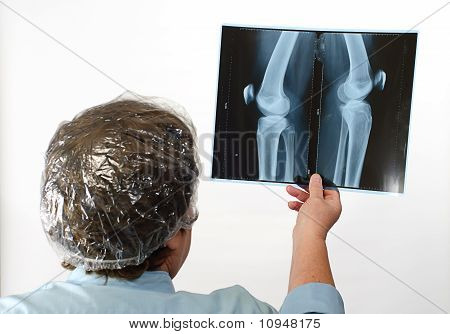 Mature Doctor Examining X-ray