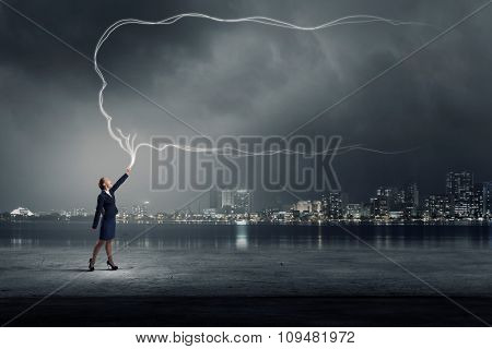 Young businesswoman catching in hand blank speech bubble