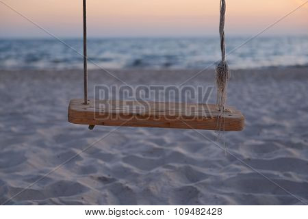Empty chain swing on the beach