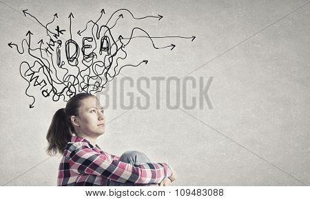 Pretty young woman making decision with arrows above her head