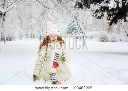 Laughing Girl In Winter Park. Happy Holiday And Childhood Concept.