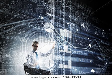 Businessman in chair working with virtual panel
