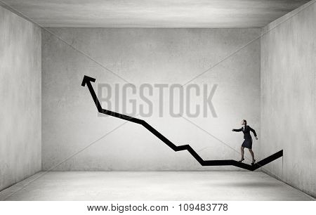 Young businesswoman running up on increasing arrow graph