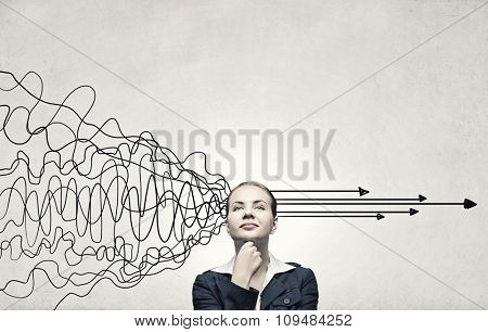 Young pensive businesswoman and arrows coming out of her head